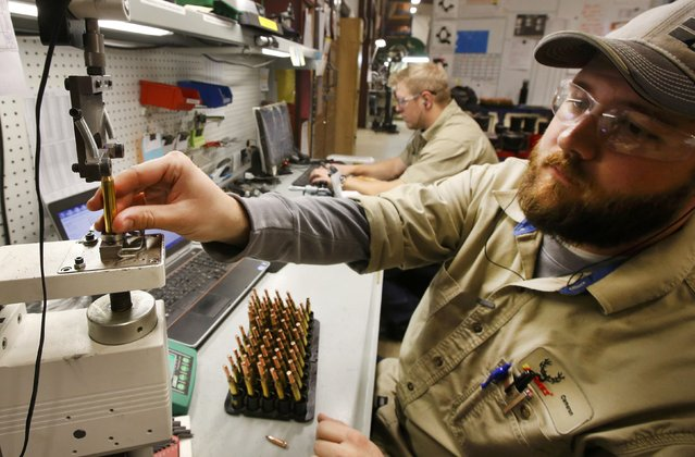 A worker tests bullets for correct tolerances at Barnes Bullets in Mona, Utah, January 6, 2015. (Photo by George Frey/Reuters)