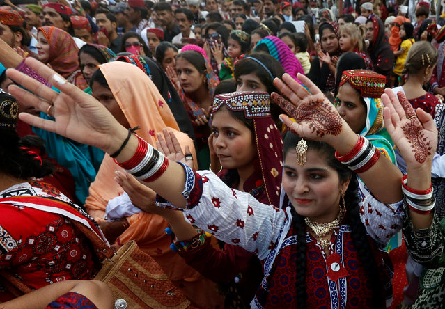 A woman dances with others during Sindh Culture Day in Karachi, Pakistan, December 4, 2016. (Photo by Akhtar Soomro/Reuters)