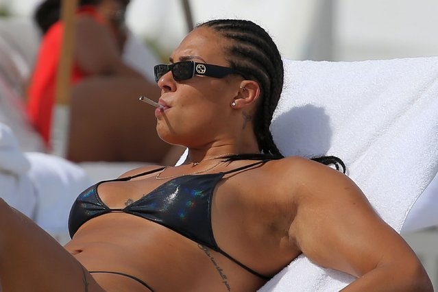 Australian professional basketball player Liz Cambage shows off her extensive tattoo collection in a tiny black bikini while having a smoke on the beach in Miami on April 7, 2021. (Photo by The Mega Agency/Profimedia)