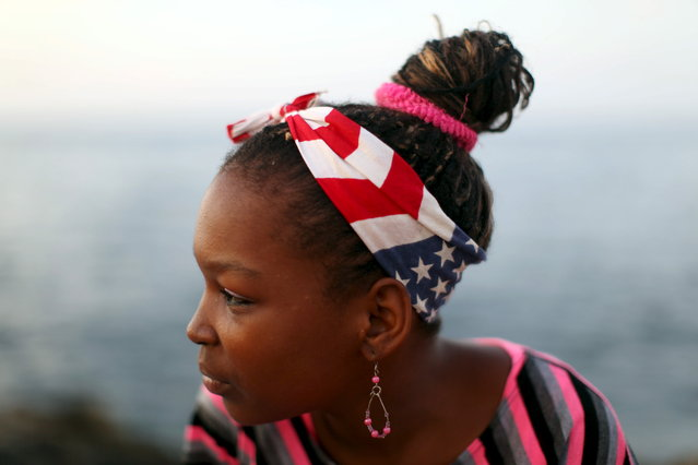 Student Yeilin Limoma, 16, sits at the seafront Malecon in Havana, July 18, 2015. (Photo by Alexandre Meneghini/Reuters)