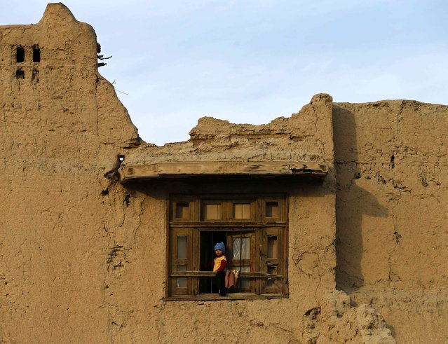 A child looks out of a window in Kabul January 29, 2015. (Photo by Mohammad Ismail/Reuters)