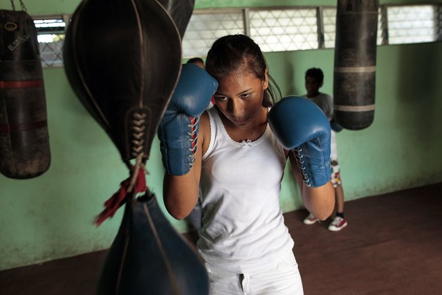 Idania Sandoval, 14, trains at the National Institute of Sport in Managua March 4, 2015. A study done by the Psychology alumni of the National Autonomous University of Nicaragua (UNAN-Managua) revealed that about 1 million women in Nicaragua suffer from domestic violence. (Photo by Oswaldo Rivas/Reuters)