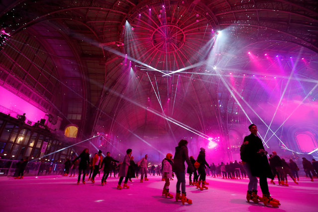 People ice skate on an ice rink at the Grand Palais exhibition hall in Paris, France, December 18, 2016. (Photo by Jacky Naegelen/Reuters)