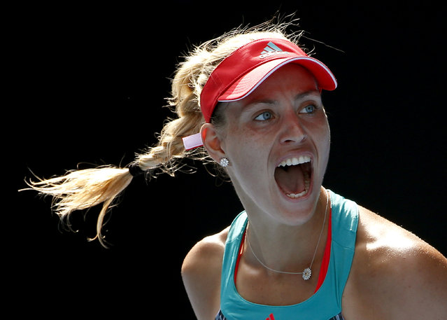Angelique Kerber of Germany celebrates after defeating Johanna Konta of Britain in their semifinal match at the Australian Open tennis championships in Melbourne, Australia, Thursday, January 28, 2016. (Photo by Vincent Thian/AP Photo)