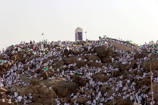 SAUDI ARABIA: Muslim pilgrims gather on Mount Mercy on the plains of Arafat during the annual haj pilgrimage, outside the holy city of Mecca, Saudi Arabia September 11, 2016. (Photo by Ahmed Jadallah/Reuters)