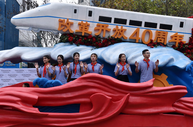 A float decorated with a high-speed train marks the 40th anniversary of China's economic reform as part of a parade in Zhejiang province, Hangzhou, China on November 18, 2018. (Photo by Reuters/China Stringer Network)