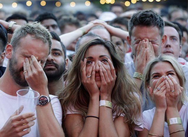 In this July 11, 2018 file photo England soccer fans react after Croatia scored their side's first goal as they watch a live broadcast on a big screen of the semifinal match between Croatia and England at the 2018 soccer World Cup, in Flat Iron Square, south London. (Photo by Luca Bruno/AP Photo/File)