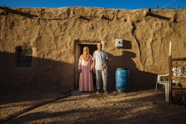 Ahmed and his wife, Ismah, live in a mud house straddling the border with Syria near their hometown of Kobane. The mud house has been their home since fleeing to Turkey two years ago, when they came across it. The mud helps the house remain cool during the summer months, and warm during the winter. (Photo by Muse Mohammed/IOM)
