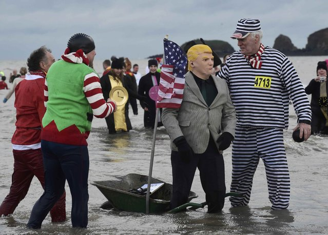A swimmer dressed as U.S. President-elect Donald Trump, stands with a swimmer dressed as a prisoner during the New Year's Day swim at Saundersfoot in Wales, Britain, January 1, 2017. (Photo by Rebecca Naden/Reuters)