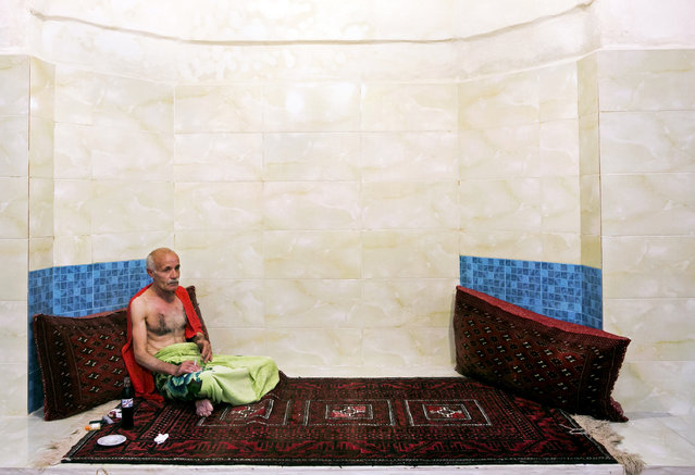 In this October 15, 2014 photo, a customer relaxes after a bath at the Nezafat public bathhouse, in Tabriz, Iran. (Photo by Ebrahim Noroozi/AP Photo)