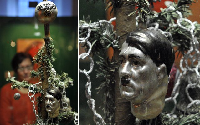 "Christmas tree decorations with a Hitler bust from the Third Reich is displayed in the Museum der Brotkultur in Ulm, Germany, 27 November 2013. The exhibition ""Aufgeputzt"" (lit Decked out) showing historical christmas decorations runs from 01 December 2013 to 12 January 2014. (Photo by Stefan Puchner/AP Images/DPA)"