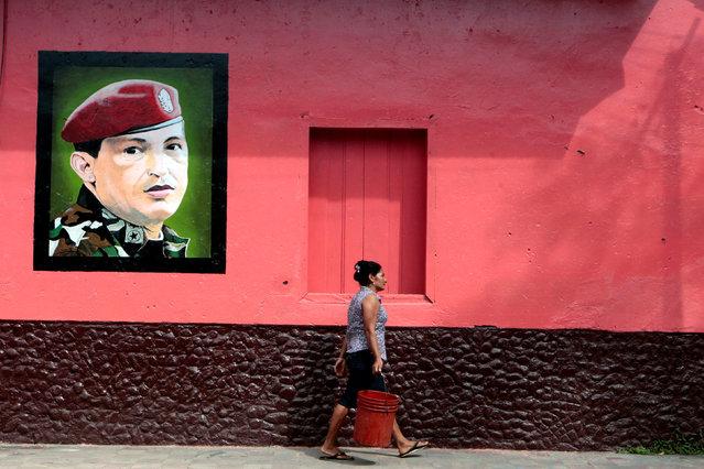 A woman walks past an image of late Venezuela's president Hugo Chavez in Altagracia town, Nicaragua January 7, 2017. (Photo by Oswaldo Rivas/Reuters)