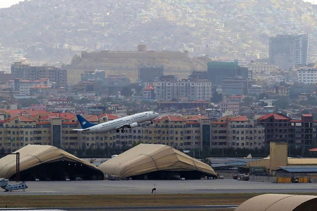 This picture taken on August 14, 2021 shows an Ariana Afghan Airlines aircraft taking-off from the airport in Kabul. (Photo by Wakil Kohsar/AFP Photo)