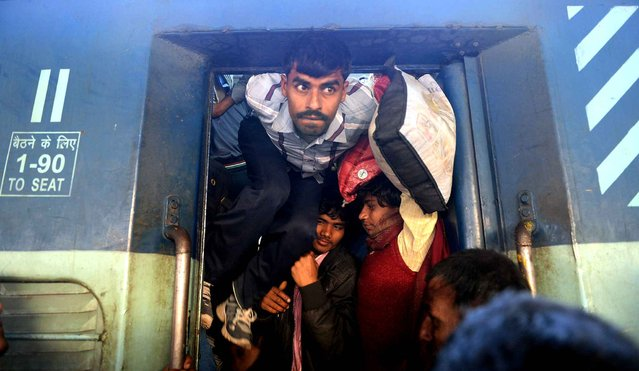 Indian passengers squeeze into the packed general wagon of The Simanchal Express at Anand Vihar Railway Station in New Delhi on February 25, 2016. Indian Railways Minister Suresh Prabhu is set to announce the Indian Railways Budget in the country's parliament. (Photo by Prakash Singh/AFP Photo)