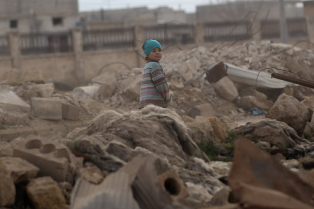 A child walks through rubble of damaged buildings in al-Rai town, northern Aleppo countryside, Syria January 20, 2017. (Photo by Khalil Ashawi/Reuters)