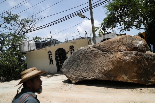 A massive rock partially blocks a road in the aftermath of the earthquake in Acapulco, in Guerrero state, Mexico, September 9, 2021. (Photo by Edgard Garrido/Reuters)
