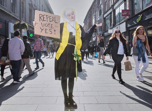 Contemporary issues story nominee: Ireland's struggle to overturn anti-abortion laws, by Olivia Harris. A 1983 referendum resulted in an amendment to the Irish constitution, reinforcing a ban on terminations, even those pregnancies resulting from rape or incest. On 25 May 2018, Ireland voted by a large majority to overturn these abortion laws, among the most restrictive in the world. Repeal campaigner Megan Scott, dressed as St Brigid, Ireland's female patron, poses for a photograph on Dublin's main shopping street. (Photo by Olivia Harris/World Press Photo 2019)