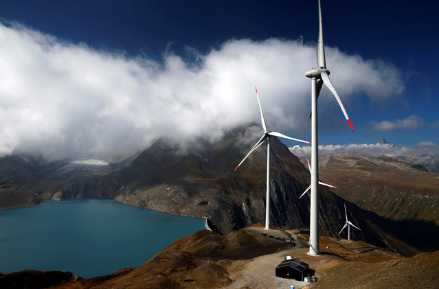 Wind turbines are pictured at Swisswinds farm, Europe's highest wind farm at 2500m, before the topping out ceremony near the Nufenen Path in Gries, Switzerland September 30, 2016. (Photo by Denis Balibouse/Reuters)