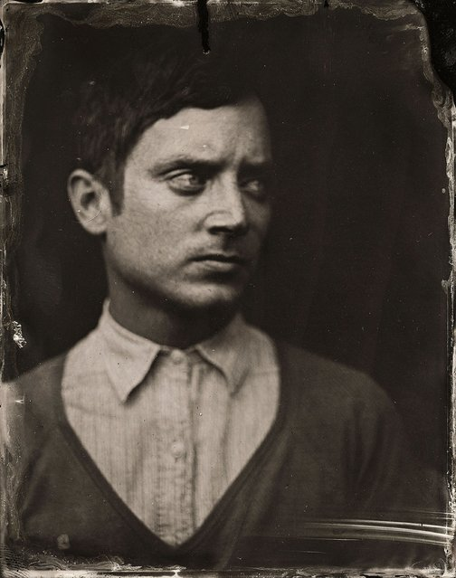 Elijah Wood poses for a tintype (wet collodion) portrait at The Collective and Gibson Lounge Powered by CEG, during the 2014 Sundance Film Festival in Park City, Utah. (Photo by Victoria Will/AP Photo/Invision)
