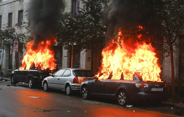Cars are set on fire by protesters during a rally against Expo 2015 in Milan, Italy, May 1, 2015. Italy opens the Milan Expo on Friday, torn between hopes that the showcase of global culture and technology will cheer up a gloomy national mood and fears that it will be overshadowed by scandal, delays and street protests. (Photo by Stefano Rellandini/Reuters)