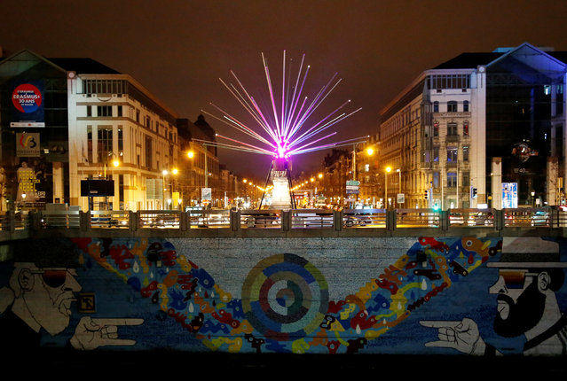 An artistic light installation illuminates the canal near the Brussels district of Molenbeek during the Bright Brussels Festival in Brussels, Belgium February 4, 2017. (Photo by Francois Lenoir/Reuters)