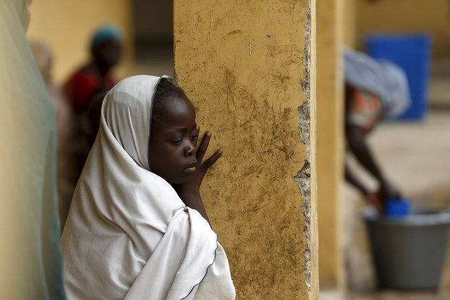 Children rescued from Boko Haram in Sambisa forest react at a clinic at the Internally Displaced People's camp in Yola, Nigeria May 3, 2015. (Photo by Afolabi Sotunde/Reuters)