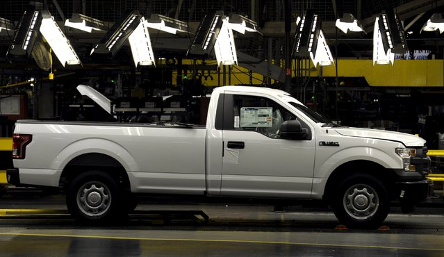 A completed Ford F150 truck is conveyed to the end of the line at the Kansas City Assembly Plant where new aluminum intensive Ford F-Series pickups are built in Claycomo, Missouri May 5, 2015. (Photo by Dave Kaup/Reuters)