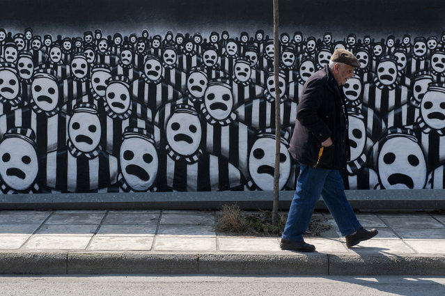 A man walks past a graffiti dedicated to the Holocaust in the northern port city of Thessaloniki March 15, 2015. Jews gathered at the northern town of Greece for an event organised by the Thessaloniki Jewish community marking the first deportation of Thessaloniki Jews to Nazi death camps during World War Two. (Photo by Alexandros Avramidis/Reuters)