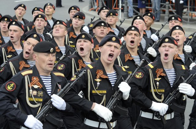 Servicemen march during the Victory Day parade in Vladivostok, Russia, May 9, 2015. Russia marks the 70th anniversary of the end of World War Two in Europe on Saturday with a military parade, showcasing new military hardware at a time when relations with the West have hit lows not seen since the Cold War. (Photo by Yuri Maltsev/Reuters)