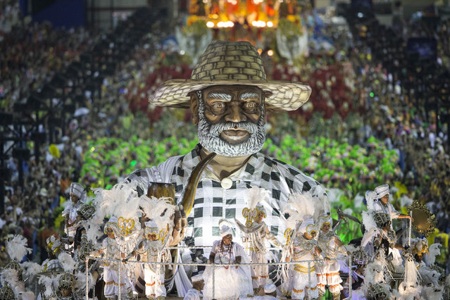 Performers from the Imperio da Tijuca samba school parade on a float during carnival celebrations at the Sambadrome in Rio de Janeiro, Brazil, Sunday, March 2, 2014. (Photo by Felipe Dana/AP Photo)