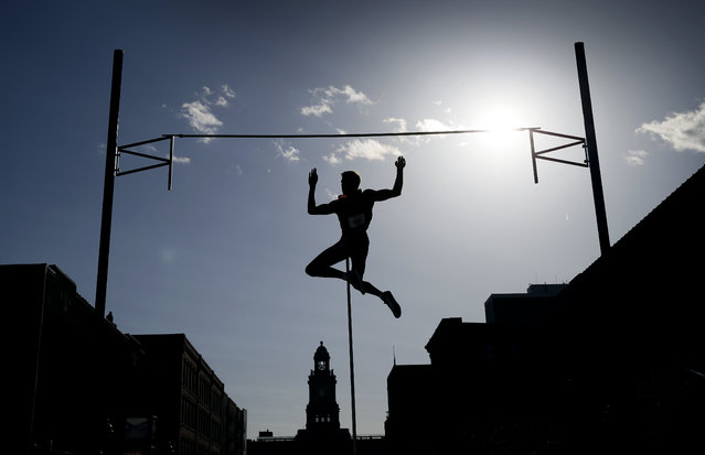 Pole vaulter Karsten Dilla, of Germany, clears the bar in the Drake Relays Street Vault, Wednesday, April 22, 2015, in downtown Des Moines, Iowa. (Photo by Charlie Neibergall/AP Photo)