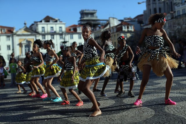 Young dancers from the Sankofa Black Gold dance association perform at the Rossio square in downtown Lisbon, Saturday, May 16, 2015. The association began in Amadora, outside Lisbon, 34 years ago to promote African dance style and music. (Photo by Francisco SecoAP Photo)