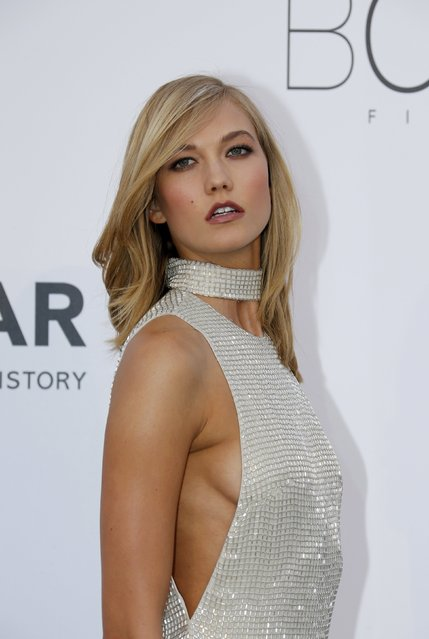 Model Karlie Kloss poses during a photocall as she arrives to attend the amfAR's Cinema Against AIDS 2015 event during the 68th Cannes Film Festival in Antibes, near Cannes, southern France, May 21, 2015. (Photo by Regis Duvignau/Reuters)