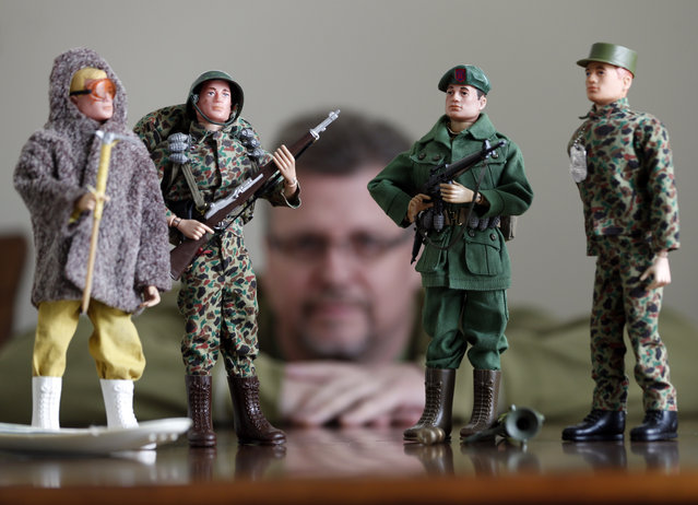 In this January 31, 2014 photo Tearle Ashby poses with some of his G.I. Joe action figures in Niskayuna, N.Y. (Photo by Mike Groll/AP Photo)