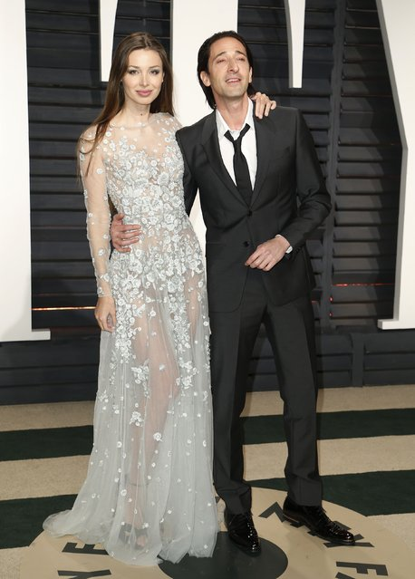 Actor Adrien Brody and Lara Lieto arrive for the Vanity Fair Oscar Party hosted by Graydon Carter at the Wallis Annenberg Center for the Performing Arts on February 26, 2017 in Beverly Hills, California. (Photo by Danny Moloshok/Reuters)