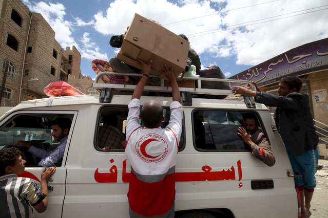 Displaced people leave an underground water tunnel after they were forced to flee their homes due to ongoing air-strikes carried out by the Saudi-led coalition in Sanaa May 2, 2015. (Photo by Mohamed al-Sayaghi/Reuters)