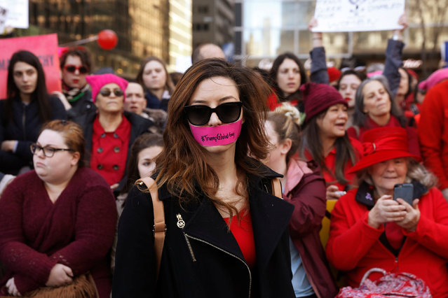 A woman with tape over her mouth takes part in a 'Day Without a Woman' march on International Women's Day in New York, U.S., March 8, 2017. (Photo by Lucas Jackson/Reuters)