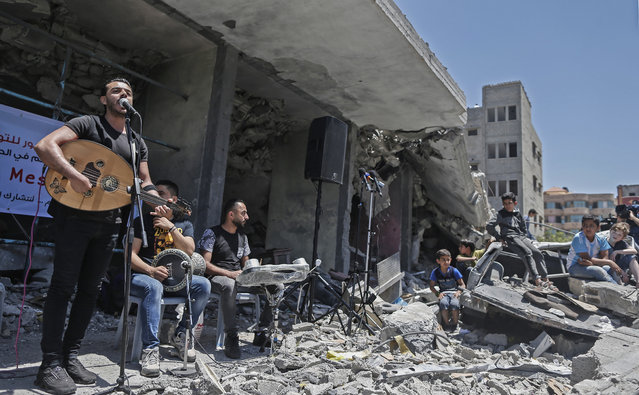 Members of the Palestinian band Dawaween perform during a musical event calling for a boycott of the Eurovision Song Contest hosted by Israel, on the rubble of a building that was recently destroyed by Israeli air strikes, in Gaza City on May 14, 2019. (Photo by Mahmud Hams/AFP Photo)