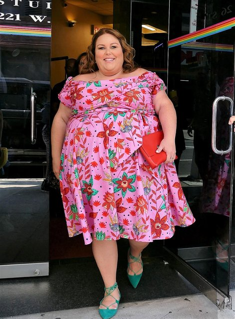 Chrissy Metz looking lovely in a pink floral dress as she leaves Wendy Williams Show in New York on July 16, 2019. (Photo by The Mega Agency)