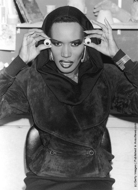 Singer and actress Grace Jones visits Madame Tussaud's to pose for a waxwork replica, 25th February 1987
