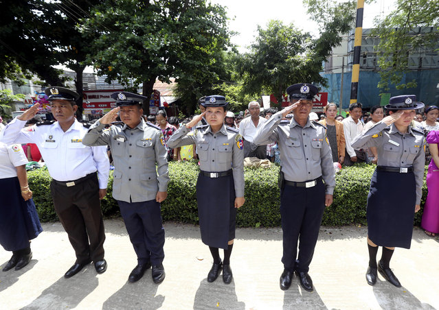 Myanmar police salute to the tomb of national hero Gen. Aung San during a ceremony to mark the 72nd anniversary of the 1947 assassination of independence heroes including Gen. Aung San, the late father of Myanmar leader Aung San Suu Kyi, Friday, July 19, 2019, in Naypyitaw, Myanmar. The country's Independence hero Gen. Aung San and his cabinet were gunned down in 1947. (Photo by Aung Shine Oo/AP Photo)
