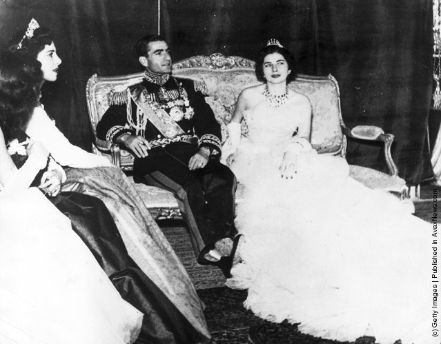 1951: Muhammad Reza Pahlavi, the Shah of Iran (1919 - 1980) with his second wife Princess Soraya Esfandiary Bakhtiari after their wedding ceremony. His sisters who acted as bridesmaids are on the left. The marriage was dissolved in 1958