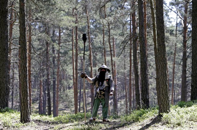 """A participant stands during the reenactment of the """"Battle of Five Armies"""" from J.R.R. Tolkien's novel """"The Hobbit"""" in a forest near the town of Doksy, Czech Republic June 6, 2015. (Photo by David W. Cerny/Reuters)"""
