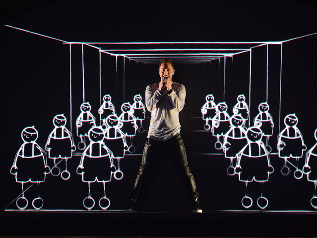 "In this Wednesday, May 20, 2015 file photo, Sweden's Mans Zelmerlow performs the song ""Heroes"" during a dress rehearsal for the second semifinal of the Eurovision Song Contest in Austria's capital Vienna. Zelmerlow won the competition last year with a performance featuring animated dancers. His victory means that Sweden is hosting this year's event, the final of which is due to take place in the capital Stockholm on Saturday, May 14. (Photo by Kerstin Joensson/AP Photo)"