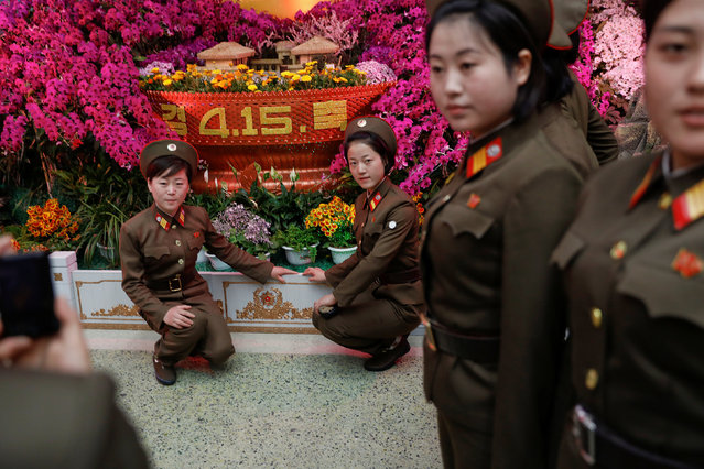 Soldiers pose for a photo during the flower exhibition marking the 105th birth anniversary of the country's founding father, Kim Il Sung in Pyongyang, North Korea April 16, 2017. (Photo by Damir Sagolj/Reuters)