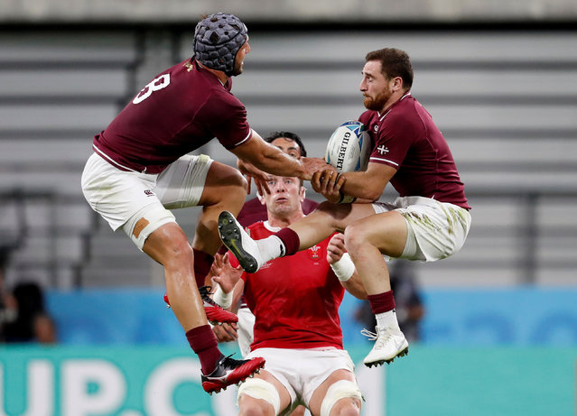 Wales' Alun Wyn Jones and Georgia's Beka Gorgadze and Vasil Lobzhanidze jump for the ball during the Japan 2019 Rugby World Cup Pool D match between Wales and Georgia at the City of Toyota Stadium in Toyota, Japan on September 23, 2019. (Photo by Issei Kato/Reuters)