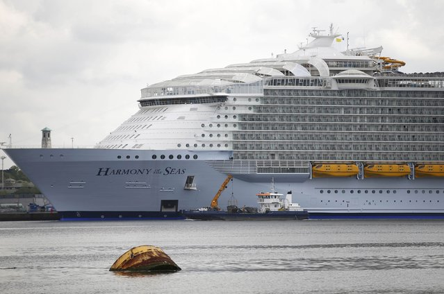 A small boats cruises past the worlds largest cruise ship, the 361 metres long, Harmony of the Seas, berthed in port ahead of its maiden voyage, in Southampton, Britain May 17, 2016. (Photo by Peter Nicholls/Reuters)