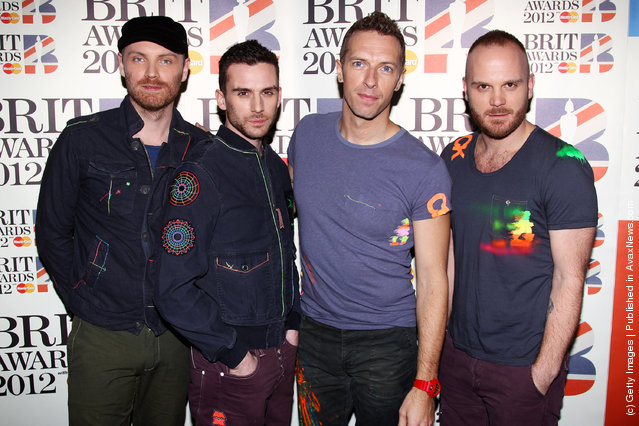 L-R Jonny Buckland, Guy Berryman, Chris Martin and Will Champion of Coldplay attend The Brit Awards 2012 at The O2 Arena