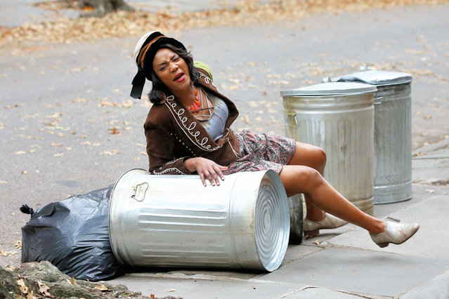 "Actress Tiffany Haddish sits on top of two garbage cans after getting shoved down by passerbys with a scraped knee only to have Billy Crystal come to her rescue filming ""Here Today"" in Brooklyn, New York on October 28, 2019. (Photo by Christopher Peterson/Splash News and Pictures)"