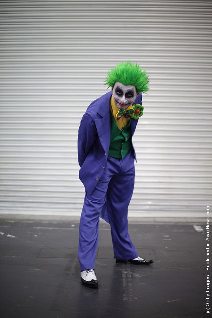 A visitor to the London Super Comic Convention wears a Joker costume at ExCel
